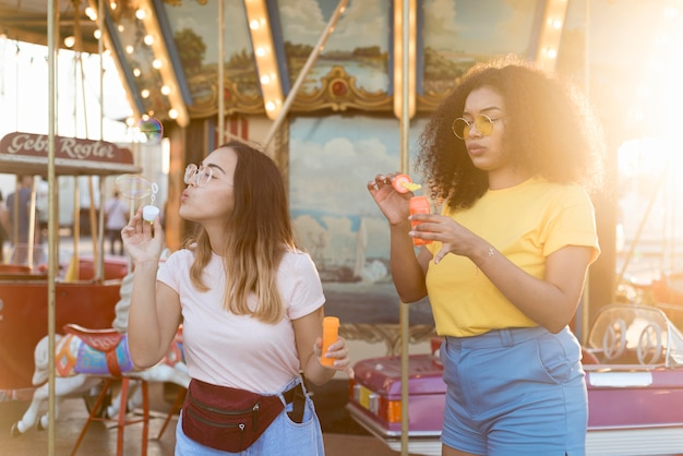 Beautiful young girls blowing bubbles