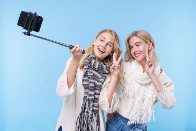 Beautiful young girls taking a selfie