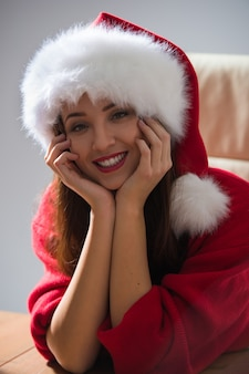 Beautiful young happy christmas woman dreaming
