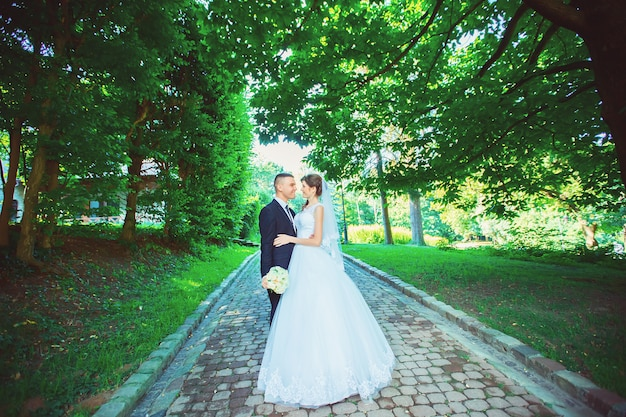 Beautiful young happy wedding couple in park, outdoor. new family.