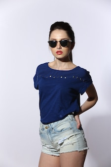 Beautiful young lady wearing jeans and sunglasses
