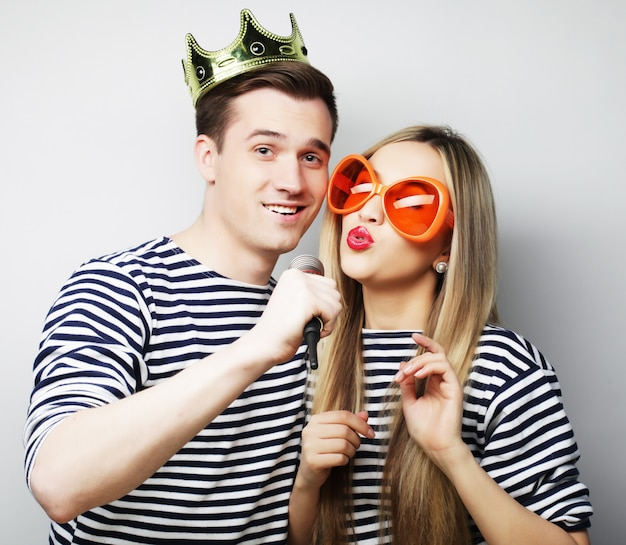Beautiful young loving couple ready for party.