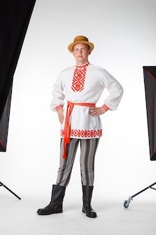 Beautiful young man in belarusian national costume