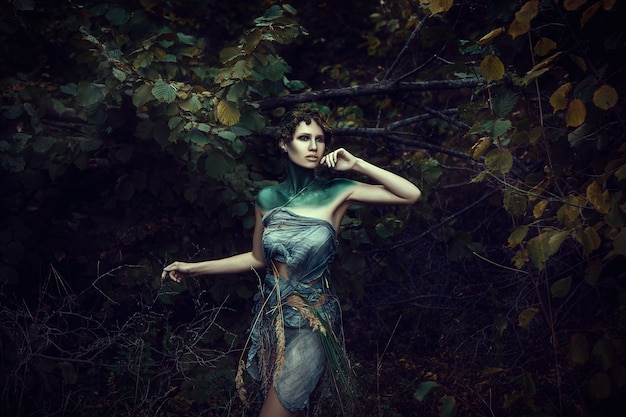 Beautiful young model is posing as a fawn