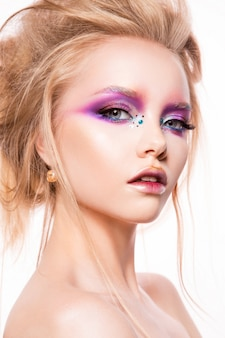 Beautiful young model with bright make-up