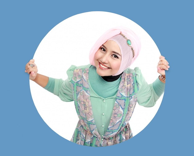 Beautiful young muslim woman in circle