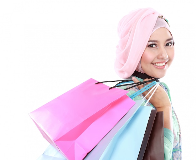 Beautiful young muslim woman holding a few shopping bags