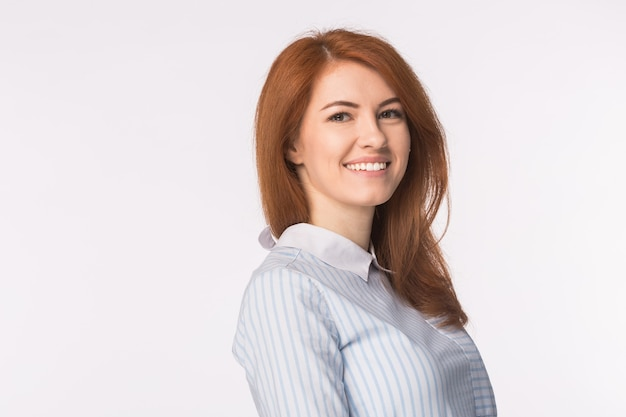 Beautiful young redhead smiling woman isolated on white