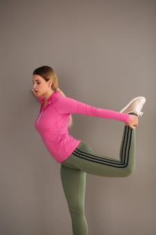 Beautiful young sporty blonde woman doing fitness exercises