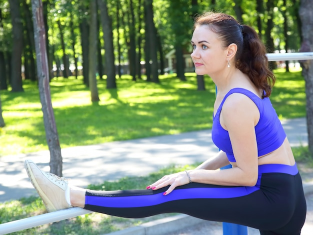 Beautiful young sporty woman doing stretching the body