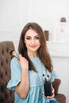 Beautiful young stylish woman visagiste