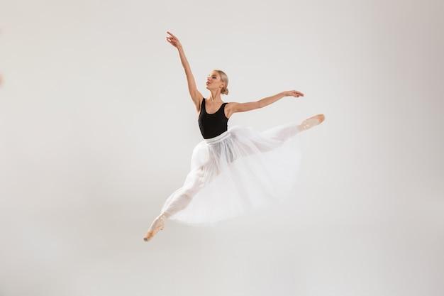 Beautiful young woman ballerina dancing