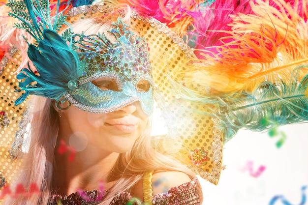 Beautiful young woman in carnival mask beauty model woman wearing masquerade mask