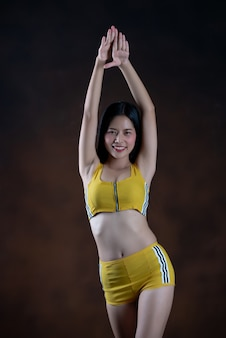 Beautiful young woman dancer posing