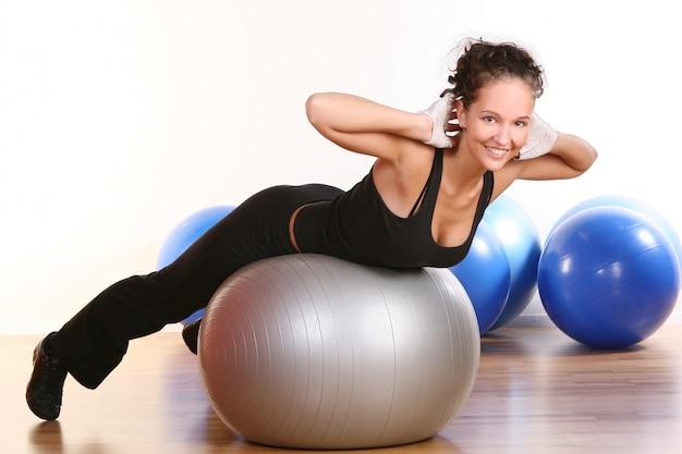 Beautiful young woman doing fitness Free Photo