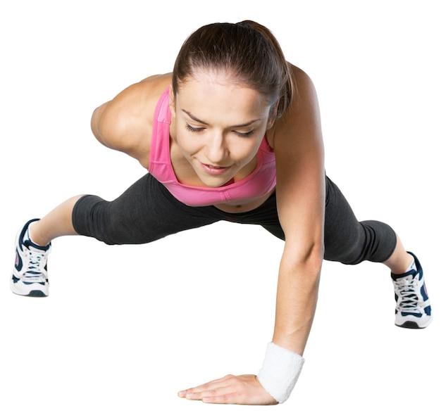 Красивая молодая женщина делает свою тренировку изолированный белый фон