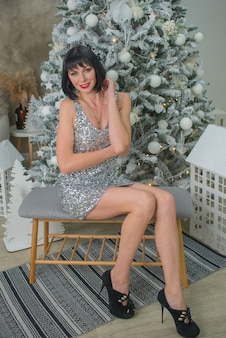 Beautiful young woman in dress on christmas eve