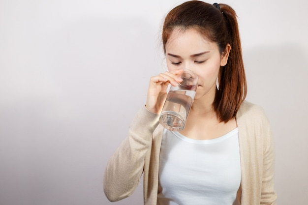 Beautiful young woman drinking a fresh glass of water