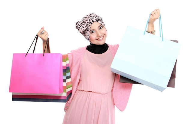 Beautiful young woman holding a few shopping bags