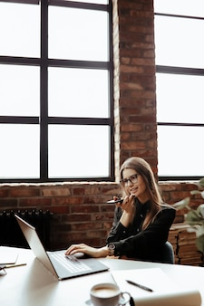 Beautiful young woman in the home office. working from home. teleworking concept