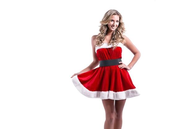 サンタクロースの衣装を着た美しい若い女性