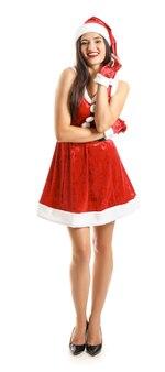 白い背景の上のサンタクロースの衣装で美しい若い女性