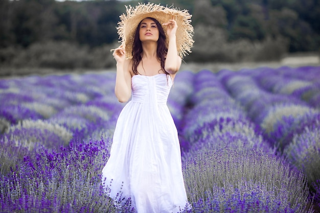 Beautiful young woman on lavender field. aroma concept. attractive young female outdoors.