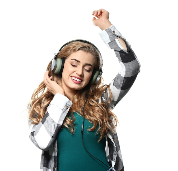 Beautiful young woman listening to music isolated