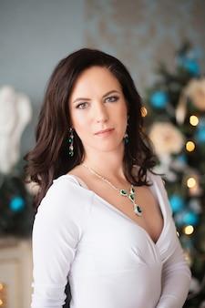 Beautiful young woman in a long white dress