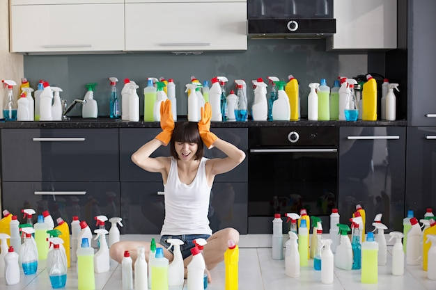 Beautiful young woman makes cleaning the house.