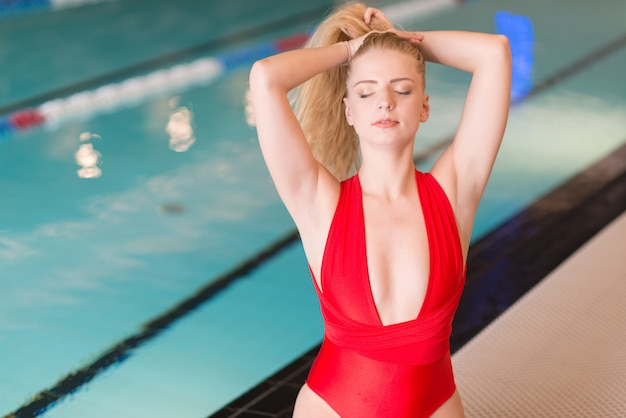 Beautiful young woman near pool