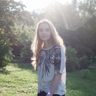 Beautiful young woman outdoors, cute attractive caucasian girl at sunny park