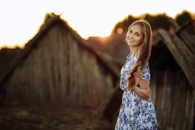 Beautiful young woman outdoors portrait. portrait of a beautiful girl against a tree house.