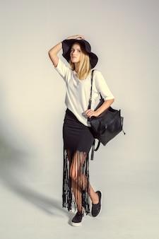 Beautiful young woman  posing in studio. fashion photo