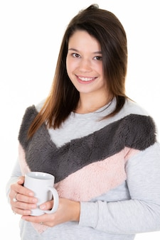 Beautiful young woman posing with cup of tea