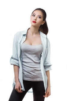 Beautiful young woman posing with serious fashion look in casual