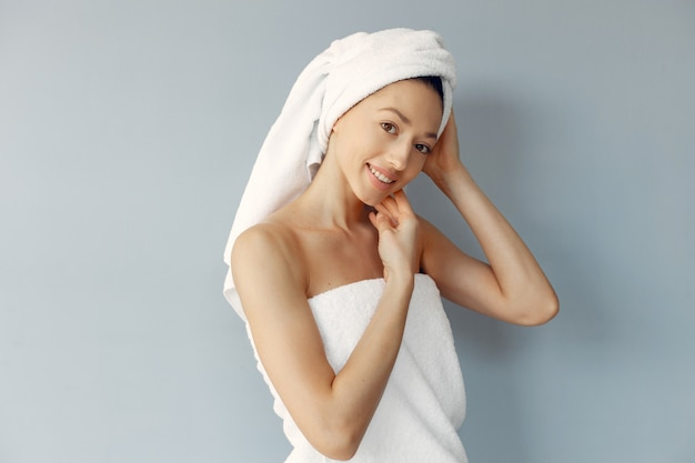 Beautiful young woman posing with towels