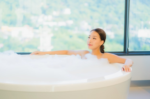 Beautiful young woman relaxing in bathtub