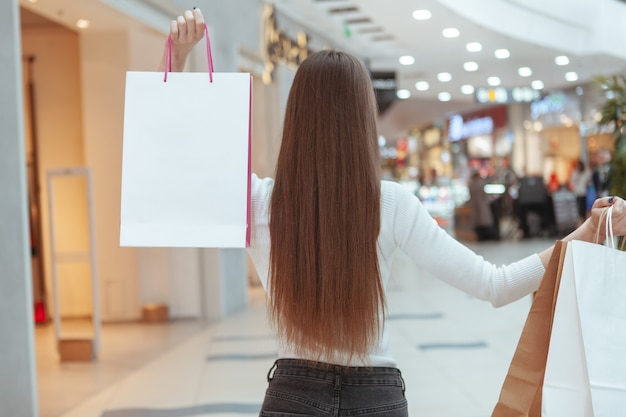 Beautiful young woman shopping at the local mall