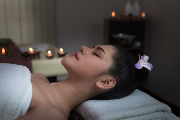 Beautiful young woman in spa salon treatment