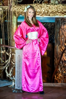 Beautiful young woman in traditional oriental kimono dress on the occasion of chinese new year celebration
