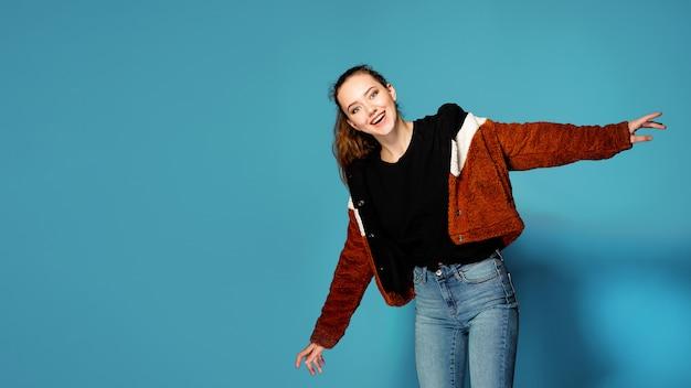 Beautiful young woman wearing autumn red coat