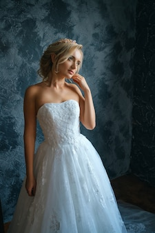 Beautiful young woman in wedding dress, beautiful bride with a make-up and hairstyle
