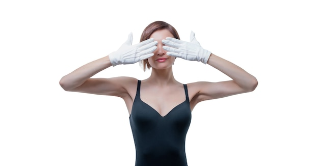 Beautiful young woman in white gloves covered her eyes with her hands
