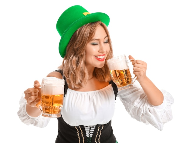 Beautiful young woman with beer on white. st. patrick's day celebration