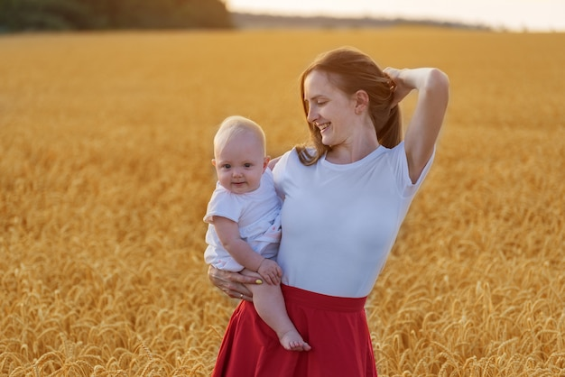 Beautiful young woman with child