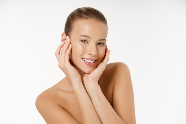 Beautiful young woman with clean fresh perfect skin