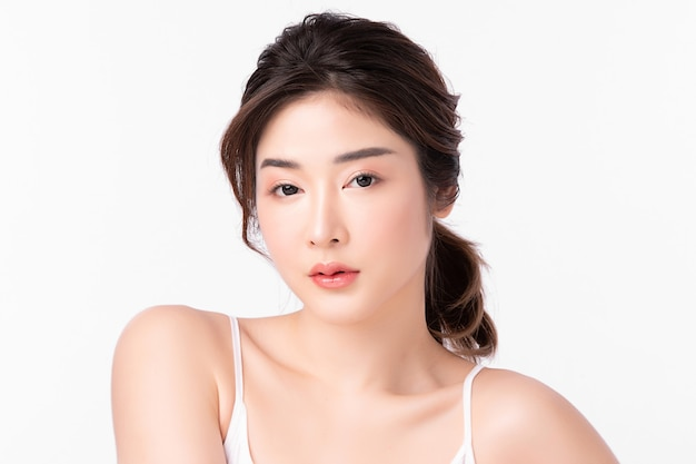 Beautiful young woman with clean fresh skin on white background, face care, facial treatment, cosmetology, beauty and spa, asian women portrait.