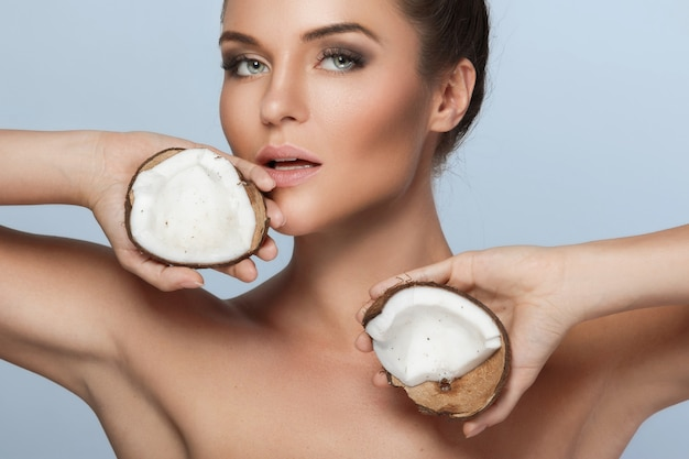 Beautiful young woman with coconut