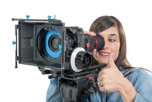 Beautiful young woman with dslr video camera, on white